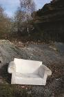Fly tipped sofa