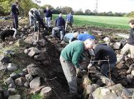 Dry stone wallers taking part in a course