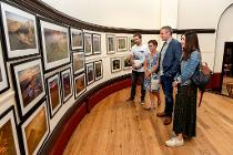 Visitors to the Call of the Wild exhibition admire the photographs