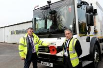 AES's Martin Sollis and Councillor Sav Scalise with one the fleet vehicles displaying a poppy in support of the Royal British Legion's annual appeal. The photograph was taken last year before the Covid restrictions were in place.