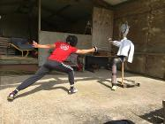 Fencer Wilfred Houston-Brown tries out his moves on a dummy