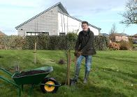 Cllr Joe Porter planting trees for the community orchard at Haregate