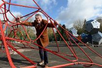 Councillor Mark Deaville taking a closer look at the new play area at Brough Park ahead of it opening